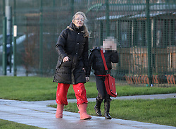 Childs face pixelated to © Under licence to London News Pictures. 27/01/2016. Karen Routh arrives at Skerne Park Acadamy in Darlington in her pyjamas to drop off her daughter (**Pictured with face pixelated**). The head teacher sent out a letter to asking parents not to wear pyjamas to drop their children off at school. Photo Credit: Stuart Boulton/LNP