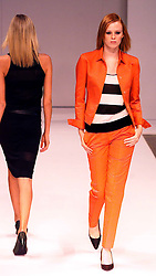 Nicole Farhi collection at London Fashion Week Spring Summer 2001. .Model on the catwalk wears orange suit. 26/9/2000.Photo by Andrew Parsons/i-Images.All Rights Reserved ©Andrew Parsons/i-images.See Instructions.