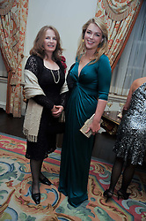 Left to right, LADY CAROLINE PRIMROSE and LADY DALMENY at a party to celebrate the publication of Gosling - Classic Design for Contemporary Interiors by Tim Gosling held at William Kent House, The Ritz Hotel, London on 1st October 2009.