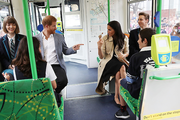 The Duke and Duchess of Sussex talks to students from Albert Park Primary School, Port Melbourne Primary School and Elwood Secondary College while riding on a tram in Melbourne, on the third day of the royal couple's visit to Australia.