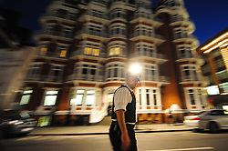 © Licensed to London News Pictures. 16/08/2012. London,UK.British police officers guard the Ecuadorian embassy where Wikileaks founder Julian Assange has sought political asylum in London, Britain, 15 August 2012 .  Photo credit : Thomas Campean/LNP