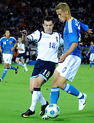Japan's Keisuke Honda tries to find a way past Scotland's Ross Wallace iduring their friendly international match in Yokohama, Japan on Saturday 10 Oct. 2009. Japan won 2-0..Photographer: Robert Gilhooly