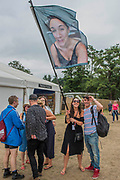 A bride to be is forced to carry a flag with a picture of herself in the bathroom by her hen party 'friends' - The 2017 Latitude Festival, Henham Park. Suffolk 15 July 2017