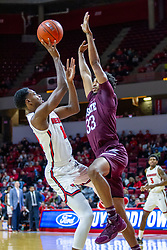 NORMAL, IL - January 07: Antonio Reeves takes a falling shot defended by Josh Hall during a college basketball game between the ISU Redbirds and the University of Missouri State Bears on January 07 2020 at Redbird Arena in Normal, IL. (Photo by Alan Look)
