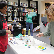 "Instructor September Krueger, left, talks with Pat Shaw during ""Create Your Own Quilt Squares"" Sunday November 23, 2014 at the Cameron Art Museum in Wilmington, N.C. (Jason A. Frizzelle)"