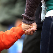 Mother Claudia Garcia from Danbury, Connecticut, holds her son Julian's hand tightly as they view the shrine set up around the towns Christmas tree in Sandy Hook after the mass shootings at Sandy Hook Elementary School, Newtown, Connecticut, USA. 17th December 2012. Photo Tim Clayton