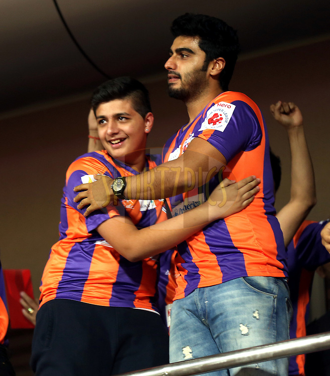 Actor Arjun Kapoor and  Kartik Wadhawan owner of FC Pune city during match 17 of the Hero Indian Super League between FC Pune City and Kerala Blasters FC held at the Shree Shiv Chhatrapati Sports Complex Stadium, Pune, India on the 30th October 2014.<br /> <br /> Photo by:  Sandeep Shetty/ ISL/ SPORTZPICS