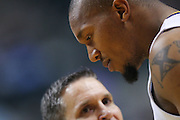 March 14, 2012; Indianapolis, IN, USA; Indiana Pacers power forward David West (21) talks to a referee against the Philadelphia 76ers at Bankers Life Fieldhouse. Indiana defeated Philadelphia 111-94. Mandatory credit: Michael Hickey-US PRESSWIRE