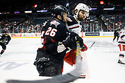 Grand Rapids Griffins' Eric Tangradi, in white, checks Lake Erie Monsters' Jaime Sifers during game 3 of the AHL Central Division finals Sunday, May 8, 2016, at Van Andel Arena in Grand Rapids, Mich. The Lake Erie Monsters beat the Grand Rapids Griffins 2-1 and lead the series 3-0. (Nick Gonzales | MLive.com)