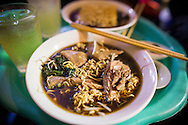 "Bowl of traditional vietnamese dish ""my ga tan"", a chicken noodle soup with an herbal based broth. Hanoi, Vietnam, Southeast Asia"