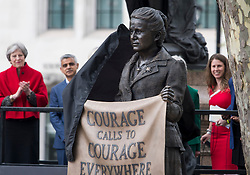 © Licensed to London News Pictures. 24/04/2018. London, UK. British Prime Minister Theresa May, Mayor of London Sadiq Khan and Campaigner Caroline Criado-Perez (far right), attend the unveiling of a statue of Millicent Fawcett in Parliament Square, London. Dame Millicent, a leading Suffragist and campaigner for equal rights for women, is the first woman to be commemorated with a statue in Parliament Square. Photo credit: Ben Cawthra/LNP