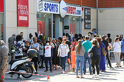 © Licensed to London News Pictures. 15/06/2020. London, UK. Shoppers queue outside Sports Direct store in Haringey, north London as non-essential stores reopen after three months of COVID-19 lockdown Photo credit: Dinendra Haria/LNP