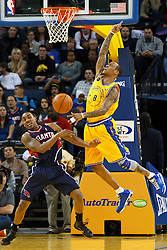February 25, 2011; Oakland, CA, USA;  Atlanta Hawks guard Jeff Teague (0) steals the ball from Golden State Warriors shooting guard Monta Ellis (8) during the first quarter at Oracle Arena. Atlanta defeated Golden State 95-79.