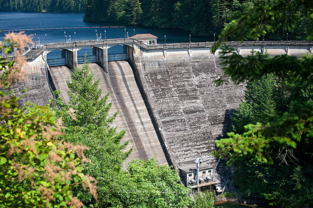 Dam 1, a curved concrete gravity dam, constructed 1925-1929, in the 102-square-mile Bull Run watershed near Mount Hood, has a maximum reservoir capacity of 10 billion gallons, making it the primary contributor to the Portland Water System Distribution Area.  The spillway gates visible in this photo, added to the dam in 1955, increased the reservoir capacity from the original 8.8 billion gallons to 10 billion gallons.