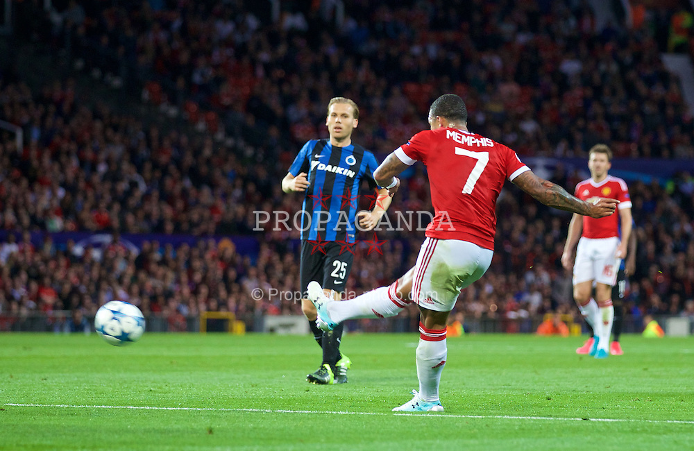 MANCHESTER, ENGLAND - Tuesday, August 18, 2015: Manchester United's Memphis Depay scores the second goal against Club Brugge during the UEFA Champions League Play-Off Round 1st Leg match at Old Trafford. (Pic by David Rawcliffe/Propaganda)
