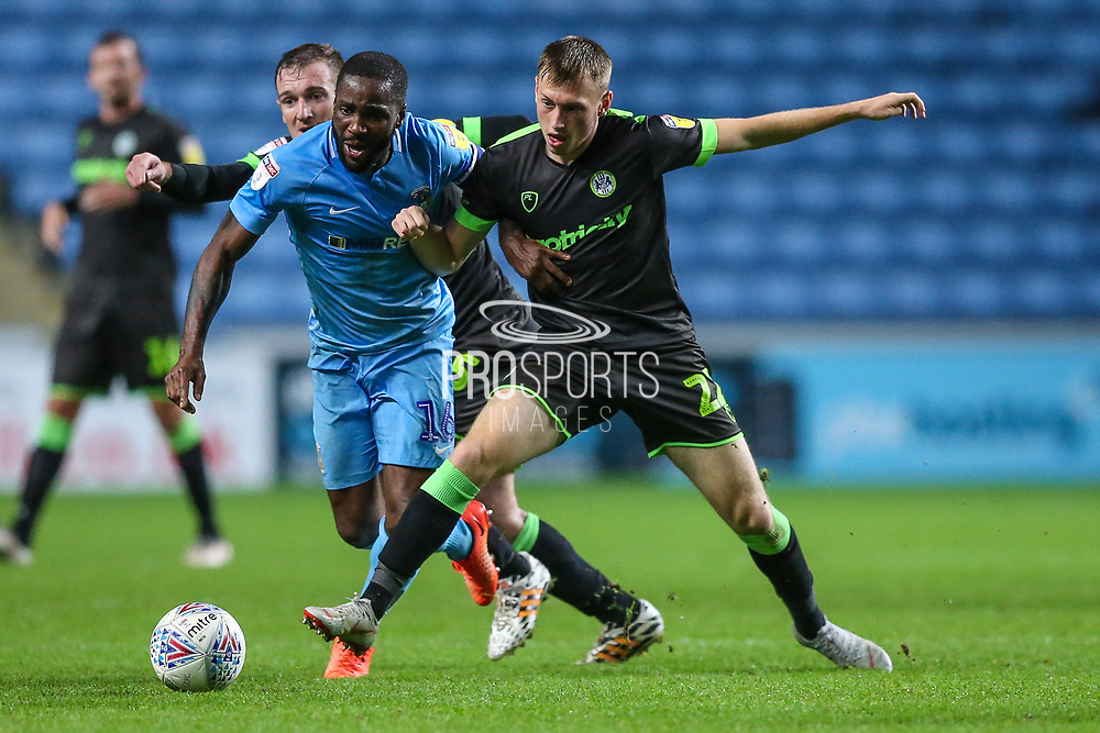 Forest Green Rovers Ben Morris(22) battles with Coventry City midfielder Abu Ogogo (16)  during the EFL Trophy match between Coventry City and Forest Green Rovers at the Ricoh Arena, Coventry, England on 9 October 2018.