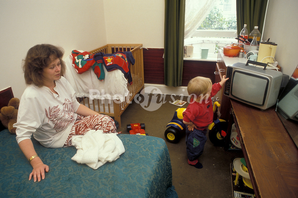 Mother and baby in bed & breakfast temporary accommodation London UK