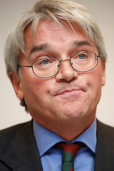 "© licensed to London News Pictures. London, UK 26/11/2013. Former chief whip Andrew Mitchell gives his reaction to the CPS decision to charge a police officer with misconduct in public office as a result of the ""Plebgate"" row at a press conference at Kingsley Napley office in London. Photo credit: Tolga Akmen/LNP"