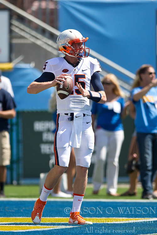 PASADENA, CA - SEPTEMBER 05:  Quarterback Matt Johns #15 of the Virginia Cavaliers warms up before the game against the UCLA Bruins at the Rose Bowl on September 5, 2015 in Pasadena, California.  The UCLA Bruins defeated the Virginia Cavaliers 34-16. (Photo by Jason O. Watson/Getty Images) *** Local Caption *** Matt Johns