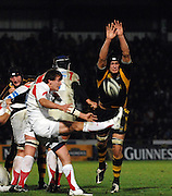 Wycombe, Great Britain, Wasps, John HART, charges, Falcon, Lee DICKSON clearence kick down, during the Guinness Premiership Game London Wasps vs Newcastle Falcon at Adams Park, England, on Sunday 25/11/2007   [Mandatory Credit. Peter Spurrier/Intersport Images]