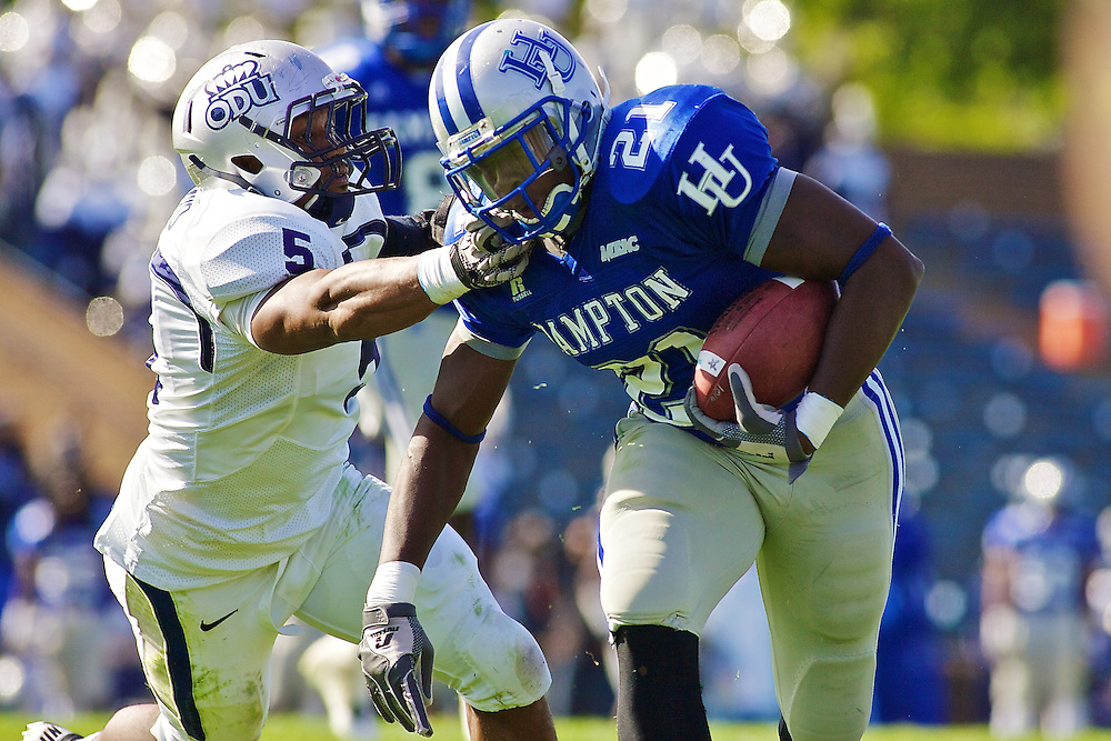 Oct 30, 2010; Hampton VA, USA; Old Dominion defensive end Deron Mayo (5) grabs the face of Hampton Pirates running back Steven Robinson (21) to try and tackle him at Armstrong Stadium. Old Dominion won 28-14Mandatory Credit: Peter J. Casey