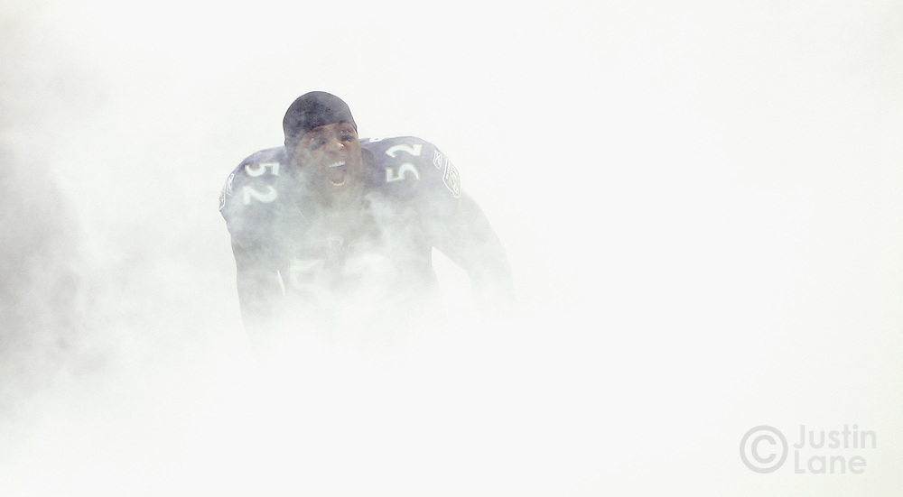 Baltimore Ravens linebacker Ray Lewis yells as he runs onto the field through smoke at the start of the 2007 AFC divisional playoff game between the Ravens and Indianapolis Colts.