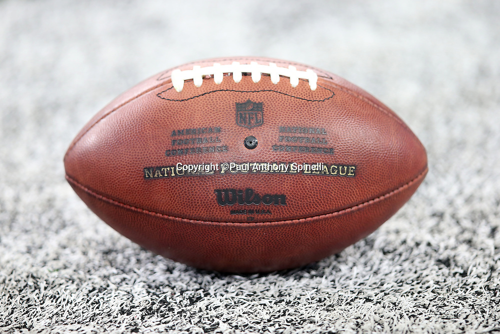 An NFL football lies on the white painted sideline turf during the Dallas Cowboys 2015 NFL preseason football game against the Houston Texans on Thursday, Sept. 3, 2015 in Arlington, Texas. The Cowboys won the game 21-14. (©Paul Anthony Spinelli)