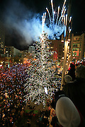 Thousands gather in Westlake Plaza in downtown Seattle to watch the lighting of the Christmas tree and the Macy's star. Fireworks commemorating the 50th anniversary of the star were fired from the roof of Macy's Department Store.<br />