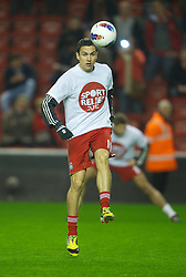 LIVERPOOL, ENGLAND - Tuesday, March 13, 2012: Liverpool's Stewart Downing warms-up with a Sport Relief t-shirt before the Premiership match against Everton at Anfield. (Pic by David Rawcliffe/Propaganda)