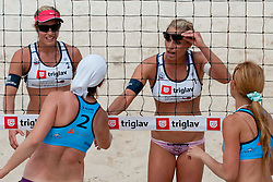 Erika in Simona Fabjan greets Mihela Istenic and Snezana Islamovic  at Zavarovalnica Triglav Beach Volley Open as tournament for Slovenian national championship on July 30, 2011, in Kranj, Slovenia. (Photo by Matic Klansek Velej / Sportida)