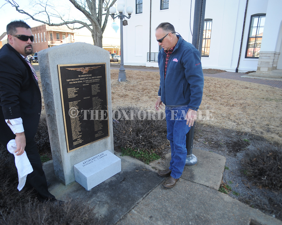 A monument is placed at the Lafayette County Courthouse in memory of Lt. Donald Carwile by Dennis Carwile and Lafayette County acting coroner Rocky Kennedy on Wednesday, January 27, 2010 in Oxford, Miss. Lt. Donald Carwile was killed in action in Afghanistan.