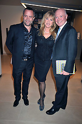 Left to right, CHRIS MILBURN, PATTI BOYD and HOWELL JAMES at the Lighthouse Gala Charity Auction in aid of the Terrence Higgins Trust held at Christie's, St.James' London on 23rd March 2009.