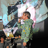 """WESTON PARK, UK:.Ian Brown of The Stone Roses on stage with bassist Gary """"Mani"""" Mounfield, at the V Festival on Sunday 19th August 2012..PHOTOGRAPH BY TERRY KANE / BARCROFT MEDIA LTD..UK Office, London..T: +44 845 370 2233.E: pictures@barcroftmedia.com.W: www.barcroftmedia.com..Australasian & Pacific Rim Office, Melbourne..E: info@barcroftpacific.com.T: +613 9510 3188 or +613 9510 0688.W: www.barcroftpacific.com..Indian Office, Delhi..T: +91 997 1133 889.W: www.barcroftindia.com"""