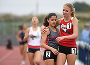 May 19, 2018; Torrance, CA, USA; Mia Barnett of Village Christian (right) and Audrey Suarez of Mayfield embrace after placing first and second in the Division IV girls 1,600m during the CIF Southern Section Finals  at El Camino College.