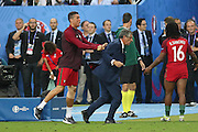 Portugal Forward Cristiano Ronaldo pushes Portugal Manager Fernando Santos to celebrate during the Euro 2016 final between Portugal and France at Stade de France, Saint-Denis, Paris, France on 10 July 2016. Photo by Phil Duncan.