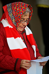 LONDON, ENGLAND - Friday, August 17, 2018: An Arsenal supporter checks out the team-sheet before the Under-23 FA Premier League 2 Division 1 match between Arsenal FC and Liverpool FC at Meadow Park. (Pic by David Rawcliffe/Propaganda)