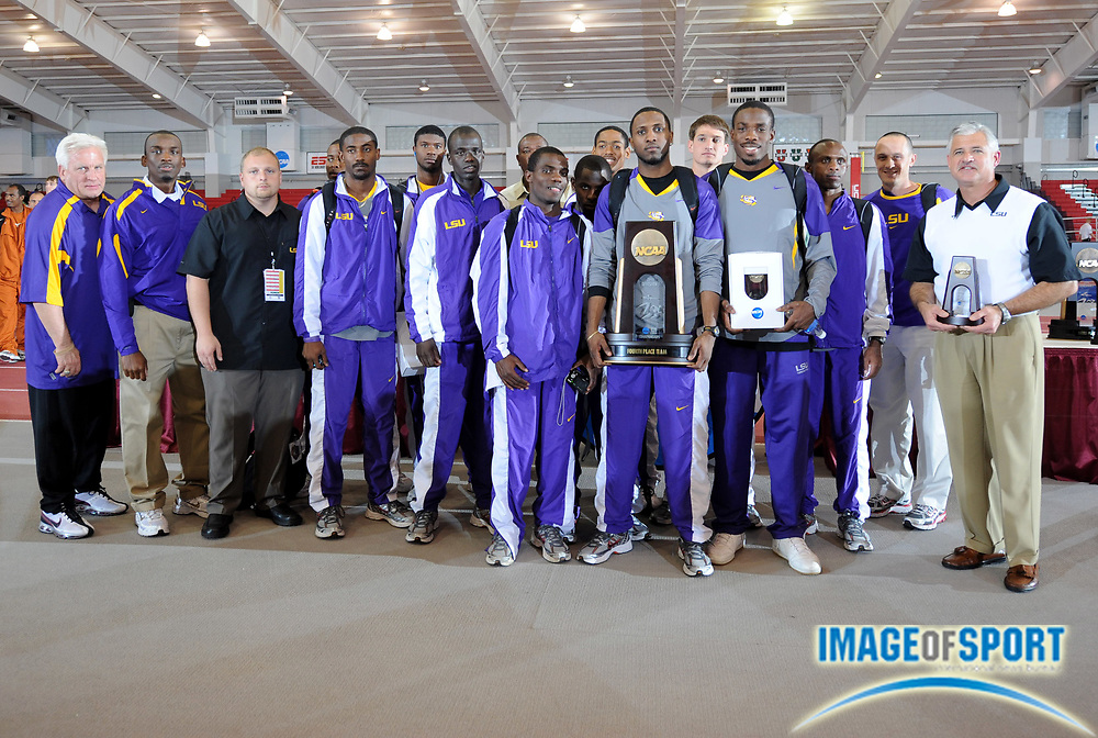 Mar 15, 2008; Fayetteville, AR, USA; The LSU men and coach Dennis Shaver pose with championship plaque after finishing fourth in the team standings in the NCAA indoor track and field championships at the Randal Tyson Center.