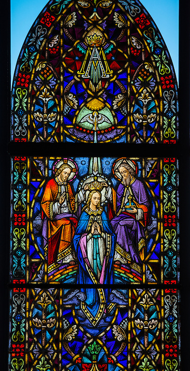 Stained glass window at Holy Family Church in Brillion, Wis. The coronation of Mary. (Sam Lucero photo)