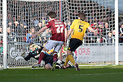Newport County Goalkeeper Joe Day makes a save at the feet of Northampton Town Striker John Marquis during the Sky Bet League 2 match between Northampton Town and Newport County at Sixfields Stadium, Northampton, England on 25 March 2016. Photo by Dennis Goodwin.