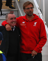 BASEL, SWITZERLAND - MAY 16: Liverpool's manager Jürgen Klopp and Chief Executive Officer Ian Ayre arrive at Basel airport ahead of the UEFA Europa League Final against Sevilla. (Photo by UEFA/Pool)