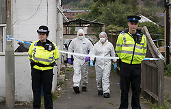 © Licensed to London News Pictures. 19/09/2016. High Wycombe, UK.  Forensics officers are seen outside a property in High Wycombe, Buckinghamshire, where detectives have launched a murder investigation following the death of a woman. A man has been arrested on suspicion of murder. Photo credit: Peter Macdiarmid/LNP