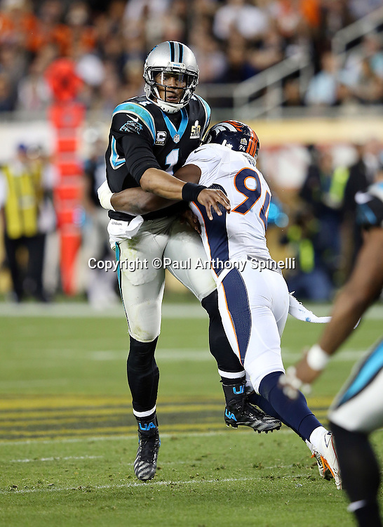 Denver Broncos outside linebacker DeMarcus Ware (94) hits Carolina Panthers quarterback Cam Newton (1) causing an incomplete pass due to his first quarter pressure during the NFL Super Bowl 50 football game against the Carolina Panthers on Sunday, Feb. 7, 2016 in Santa Clara, Calif. The Broncos won the game 24-10. (©Paul Anthony Spinelli)