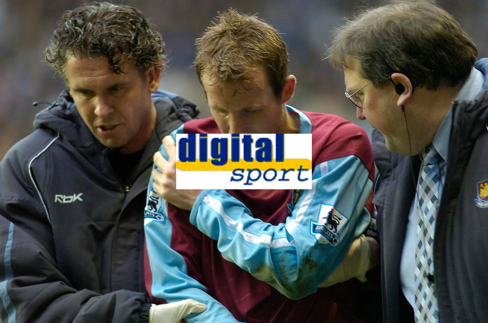 Photo: Gareth Davies.<br /> <br /> Reading v West Ham United. The Barclays Premiership. 01/01/2007.<br /> <br /> West Ham's Lee Bowyer (C) leaves the pitch with a suspected dislocated shoulder.
