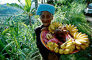Old lady selling Bananas and Snake Fruit.