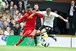 LONDON, ENGLAND - Sunday, May 12, 2013: Liverpool's Daniel Sturridge in action against Fulham's Aaron Hughes during the Premiership match at Craven Cottage. (Pic by David Rawcliffe/Propaganda)