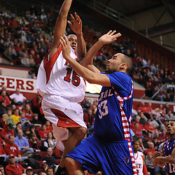 Jan 31, 2009; Piscataway, NJ, USA; Rutgers forward J.R. Inman (15) takes a shot over the block of DePaul center Krys Faber (33) during the second half of Rutgers' 75-56 victory over DePaul in NCAA college basketball at the Louis Brown Athletic Center