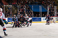 KELOWNA, CANADA - DECEMBER 29:  Mark Liwiski #9 and Kyle Topping #24 of the Kelowna Rockets check Martin Lang #22 and Quinn Schmiemann #25 of the Kamloops Blazers on December 29, 2018 at Prospera Place in Kelowna, British Columbia, Canada.  (Photo by Marissa Baecker/Shoot the Breeze)
