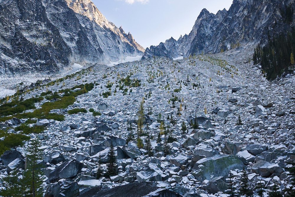 Dragontail Peak and the boulder / talus field above Colchuck Lake covered in an Autumn snow, Washington Cascades, USA.
