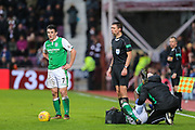 John McGinn (#7) of Hibernian prepares to take a free kick as Marvin Bartley (#6) of Hibernian receives treatment during the William Hill Scottish Cup 4th round match between Heart of Midlothian and Hibernian at Tynecastle Stadium, Gorgie, Scotland on 21 January 2018. Photo by Craig Doyle.