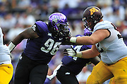 FORT WORTH, TX - SEPTEMBER 13:  Chucky Hunter #96 of the TCU Horned Frogs rushes against the Minnesota Golden Gophers on September 13, 2014 at Amon G. Carter Stadium in Fort Worth, Texas.  (Photo by Cooper Neill/Getty Images) *** Local Caption *** Chucky Hunter